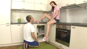 Fiery redhead enjoys being banged in the kitchen